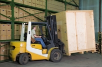 Man operating a forklift in Warehouse facility