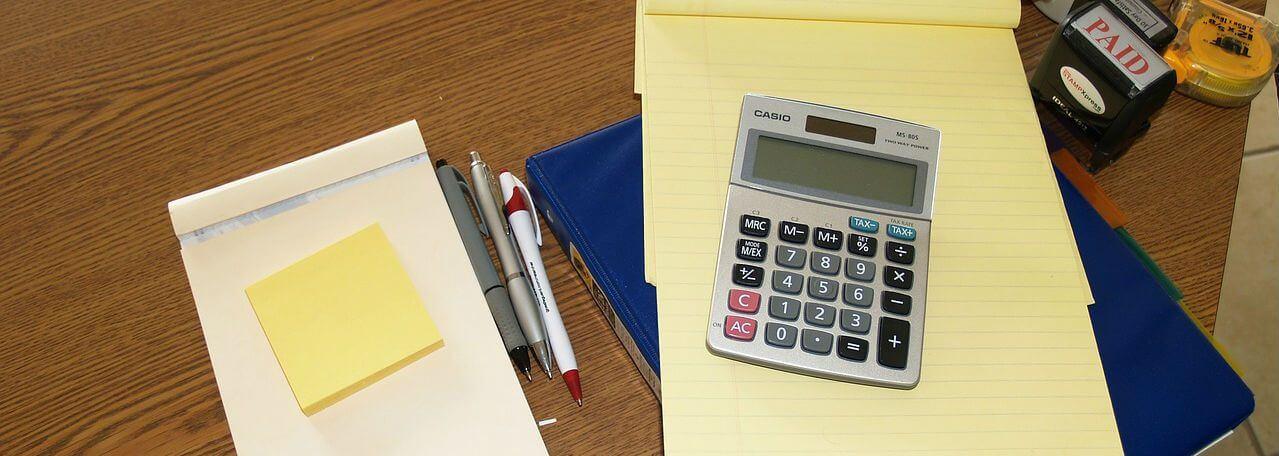 calculator lying on a notepad